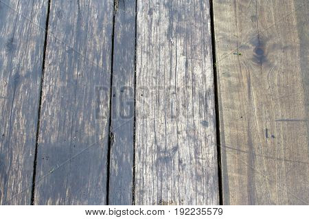 Natural hardwood Board is wet after rain. Background of wood gray. The texture of the wet wood.