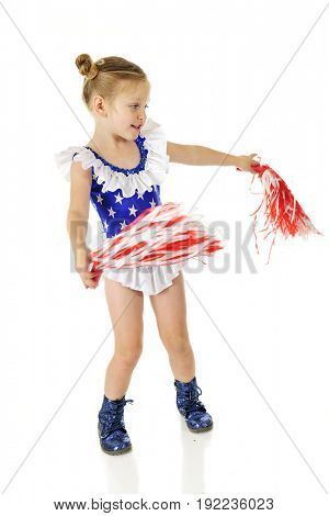 An adorable preschooler in a blue outfit with white stars and ruffles, and sparkly blue shoes.  She's waving red and white pom poms.  Motion blur on the pom poms.  Isolated on white.