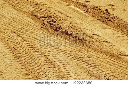 Car Tracks On Sand Road.