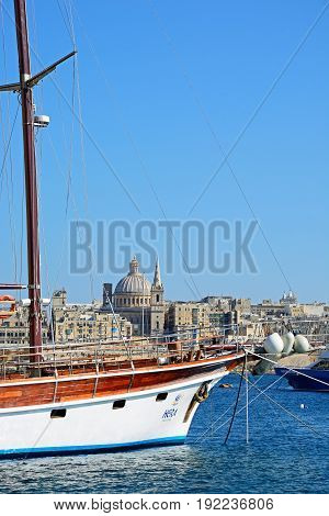 SLIEMA, MALTA - MARCH 30, 2017 - Yacht moored along the quayside with views across the Grand Harbour towards Valletta Sliema Malta Europe, March 30, 2017.
