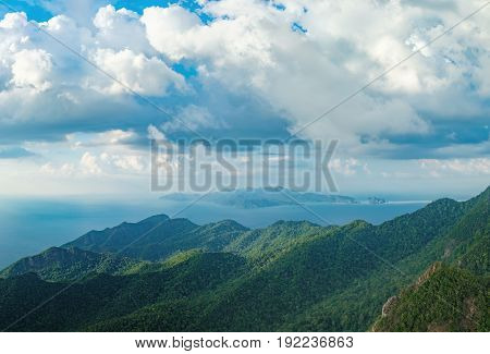 Panoramic view of blue sky sea and mountain seen from Cable Car viewpoint, Langkawi, Malaysia. Picturesque landscape with tropical forest beaches small Islands in waters of Strait of Malacca