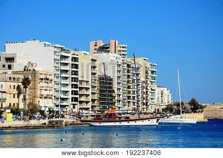 SLIEMA, MALTA - MARCH 30, 2017 - View along with waterfront with yachts moored along the quay Sliema Malta Europe, March 30, 2017.