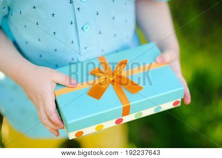 Close-up Of Nicely Wrapped Gift Being Held By A Child With No Face Visible