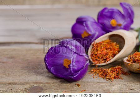 Crocus Flowers And Spoon With Soffron  On Wooden Table