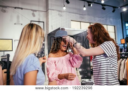 Shot of friends enjoying shopping together in the store.
