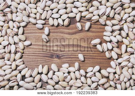 Dry Pistachios On Wooden Background. Food Frame
