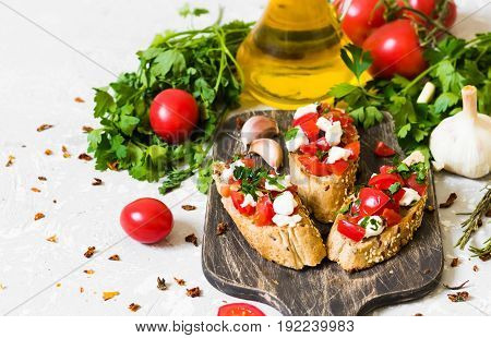 Bruschetta with tomatoes and curd cheese on whole wheat bread