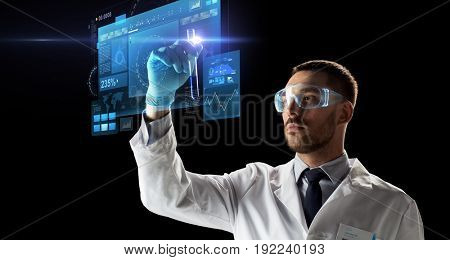 science, research and people concept - young scientist in safety glasses with test tube and virtual screens