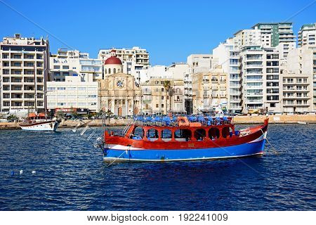SLIEMA, MALTA - MARCH 30, 2017 - View along with waterfront with the Parish church of Jesus of Nazareth in the centre Sliema Malta Europe, March 30,  2017.