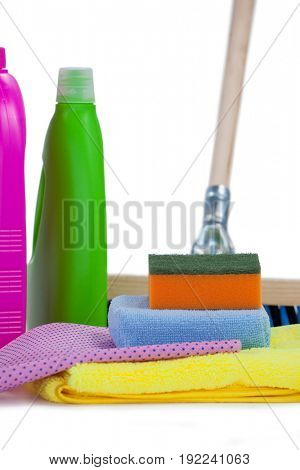 Detergent containers, scouring pad, towel, napkin cloth and floor mop arranged on white background