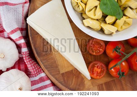 Close-up of pasta with cheese, tomatoes, garlic and napkin cloth
