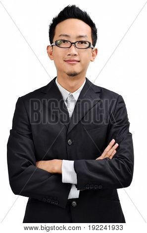 Front view of young crossed arms Asian businessman in full suit standing isolated on white background.