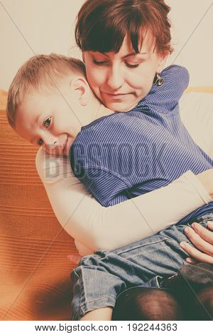 Family love beauty of parenting concept. Mother hugging her son little young boy.