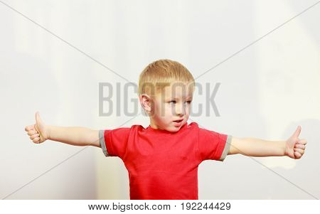 Little Boy Playing Showing Thumb Up Gesture