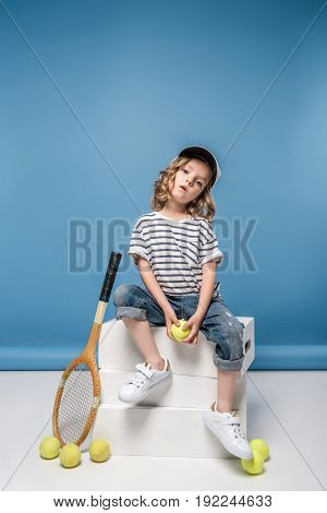 Beautiful Blonde Little Girl With Tennis Equipment Holding Yellow Ball