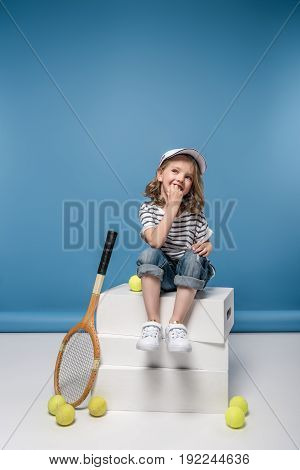 Adorable Smiling Little Girl With Tennis Raquet And Balls
