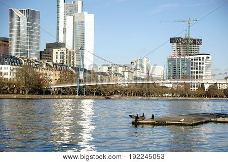 FRANKFURT, GERMANY - JANUARY 05: The skyline of the The Riverside Financial District behind the Holbeinsteg and the river Main on January 05, 2017 in Frankfurt.