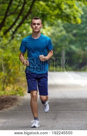 Young Boy Jogging Through Forest