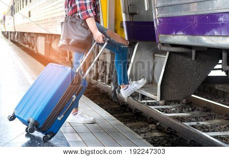 Tourists with luggage are walking on the train.