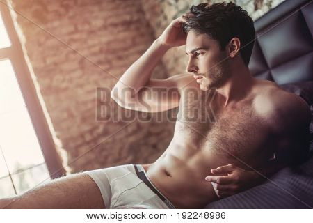 Handsome Man On Bed