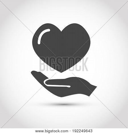 gray heart on hand. Isolated stock vector illustration