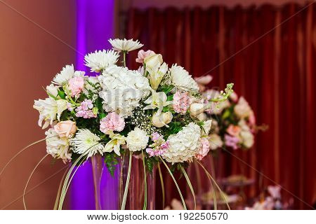 Bouquet of flowers in pots in a restaurant Flowers bouquet close up background