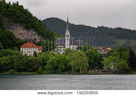 Bled Lake, shoreline mountain, alpine village in sunny weather, Slovenia, Europe.