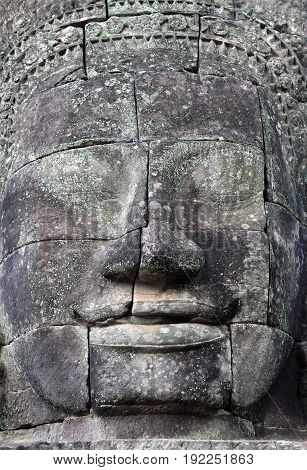 Giant stone face - ancient bas-relief of Prasat Bayon temple (late 12th - early 13th century) in Angkor Thom, Cambodia
