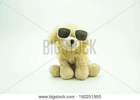 Dog doll with sun glasses isolated white backเround