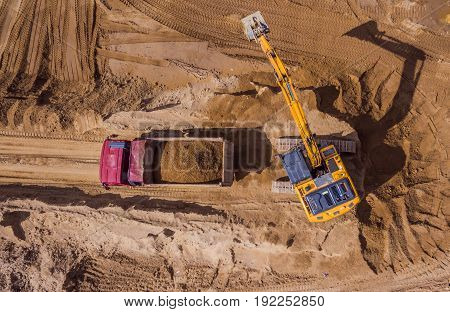 Aerial view of excavator working on construction site