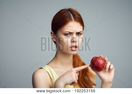 Diet, apple, healthy diet, slimming, girl holding an apple, health, beauty, girl on a gray background.