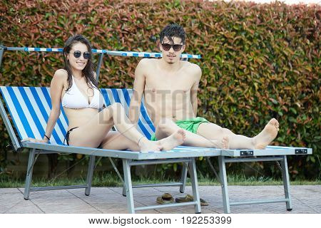 young Couple relaxing in swimming pool in summer