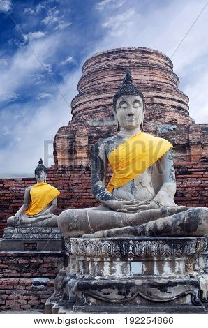 Ancient Buddha statues in Wat Yai Chaimongkol in Ayutthaya Thailand