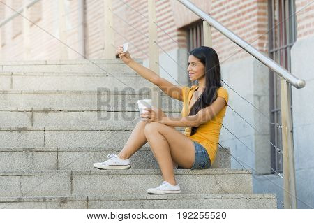 Attractive Latin Woman Talking On Her Smart Phone.