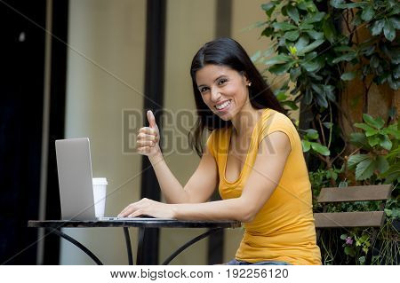 Attractive Latin Woman Working Outside On Laptop