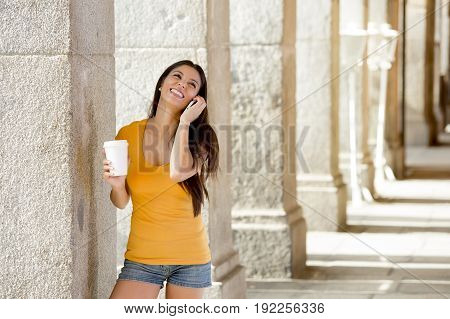 Attractive Latin Woman On Her Smart Phone
