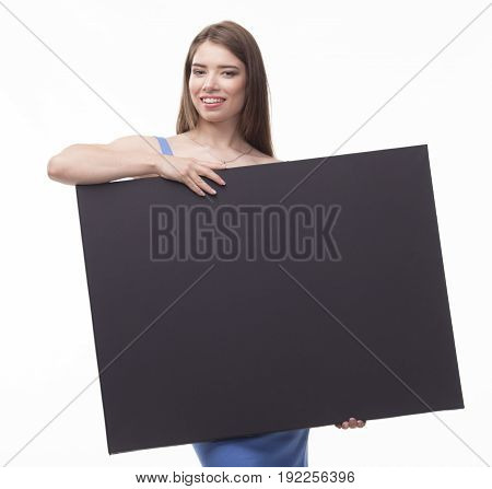 Young happy woman portrait of a confident businesswoman showing presentation, pointing placard black background. Ideal for banners, registration forms, presentation, landings, presenting concept.