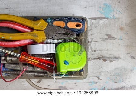 Various tools in the box on white background