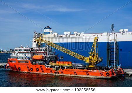Labuan,Malaysia-June 15,2017:Platform supply vessel (PSV) offshore support vessel,ready to the offshore oil production fields from port at Labuan,Malaysia on 15th June 2017