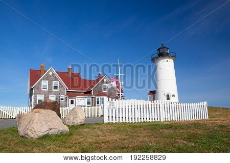 Cape Cod USA - July 12 2016: Nobska Light also known as Nobska Point Light is a lighthouse located in Woods Hole on the southwestern tip of Cape Cod Massachusetts.