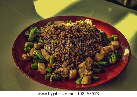 healthy meal for bodybuilder served on red plate