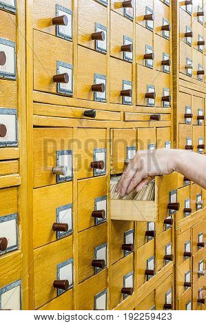 Old wooden card catalogue in library. Front view. Education background concept.