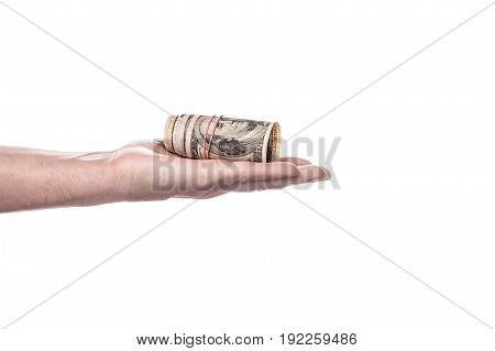 Money in hand isolated on white background. man hand giving 100 dollar bills