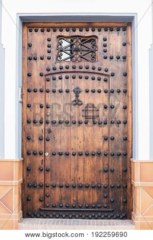 Wooden front door to the house of the outside