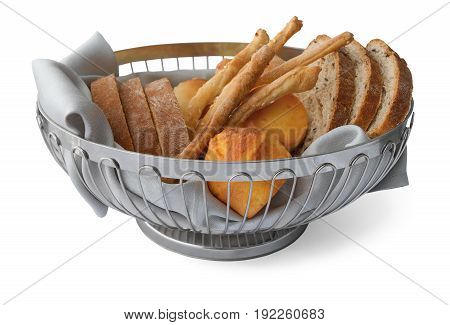 Slices of bread, bread sticks and corn bread (proja) in basket on a white background