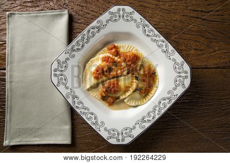 Dumplings With Meat With Tomato On A Plate - Pierogi
