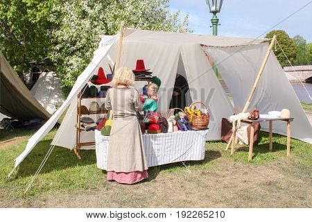St. Petersburg Russia - 28 May, People at the tent with the goods, 28 May, 2017. Festival of the Legends of the Norwegian Vikings in St. Petersburg.