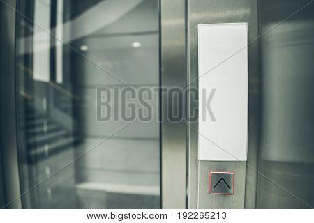 modern glass elevator control panel. go up