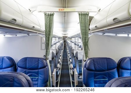 View of the interior from the business class and view of the economy class in the plane