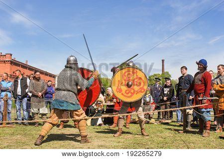 St. Petersburg Russia - 28 May, Fight with shields on swords, 28 May, 2017. Knight tournament at the festival of ancient Vikings in St. Petersburg.